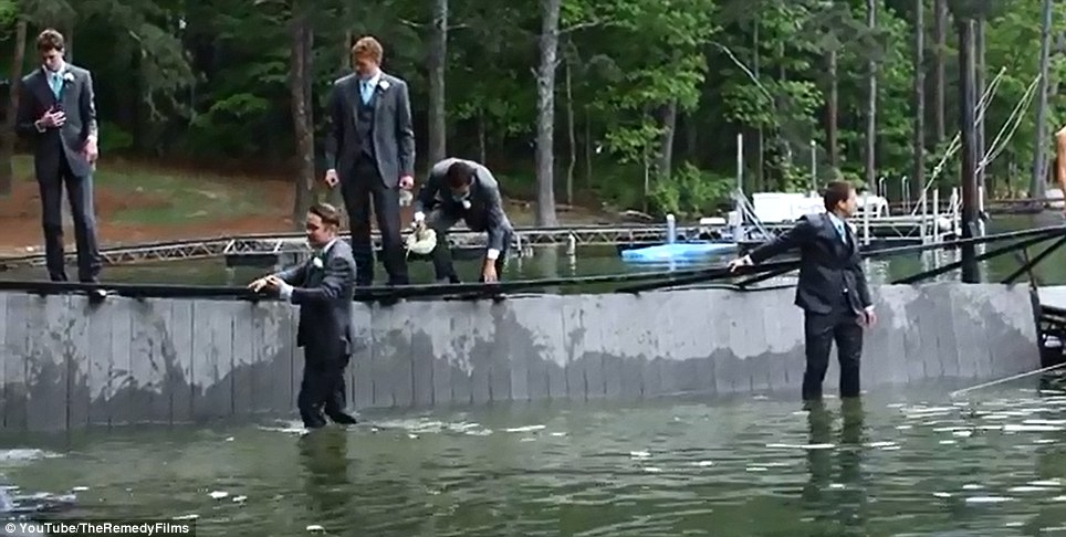 Surveying the damage: The groomsmen paddle to the shore - and hit the dancefloor in their wet suits