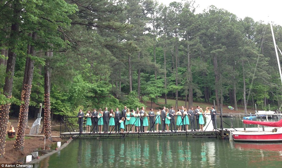 Before: An image shows the 29 members of a wedding party lining a dock, ready for photographs