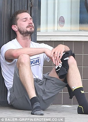 In the zone: Before Mia arrived, Shia took a shoeless breather outside, exasperated by his martial arts class