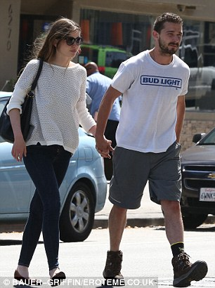Let me be your guide: Shia took the lead as they cut across traffic
