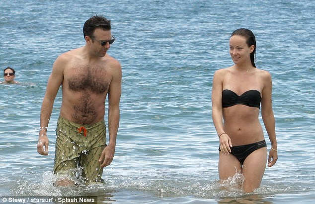 Eyes only for her: Jason kept stealing looks at his fiancee as they jumped in and out of the water