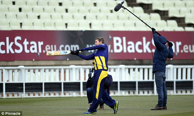 Middling it: Glamorgan's Chris Cooke swings the bat... and celebrates after hitting a clay pigeon (below)