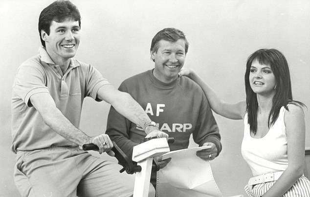 Fighting fit: Frank Stapleton tries out United's fitness computer, watched by Alex Ferguson, and Alison King