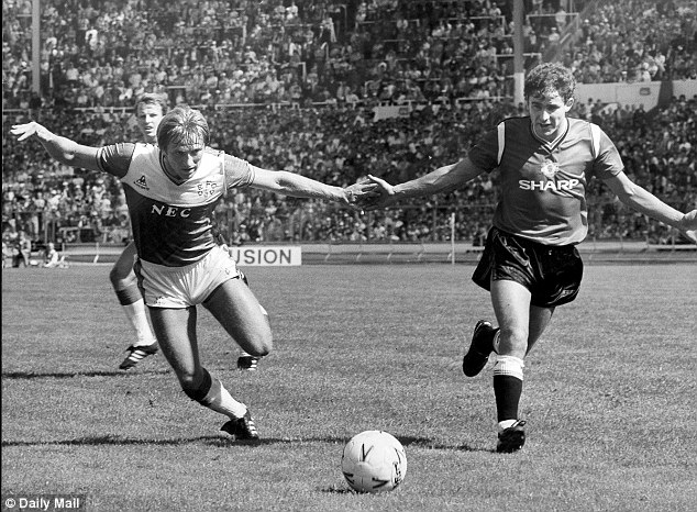 Stalwart: Arthur Albiston (right) is tenth in the club's all-time appearance records