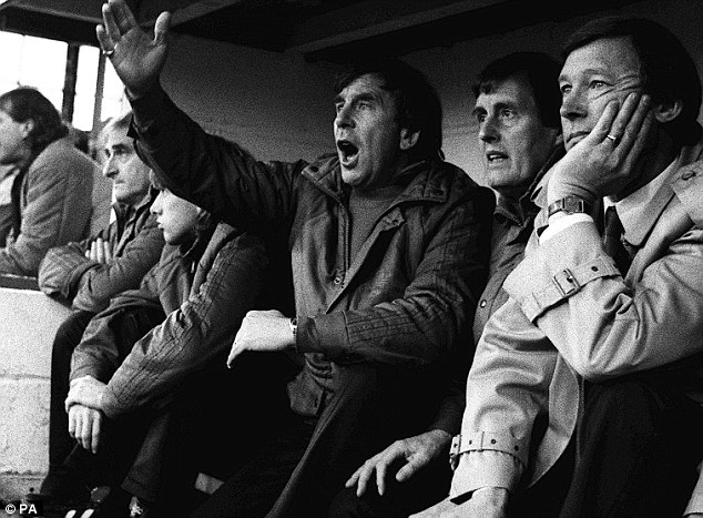 Debut: Alex Ferguson (right) watches his new Manchester United side from play Oxford United's Manor Ground