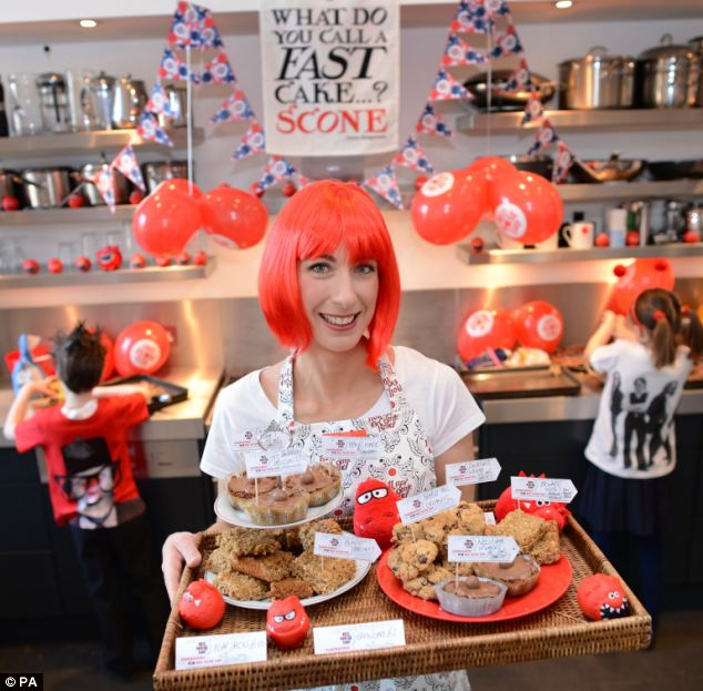 Fun: The PM's wife donned a bright red wig in the run-up to Comic Relief's Red Nose Day  as she baked cakes in her Downing Street kitchen