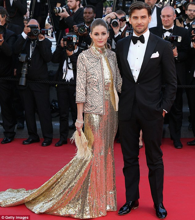 Golden girl: The 27-year-old wore her up-do to the The Immigrant premiere with Johannes Huebl and dressed in a floor-length sequin gown