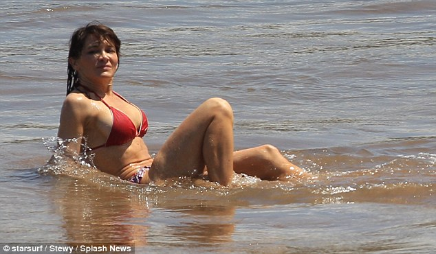 Strike a pose: Tess looked like a supermodel as she cooled off in the calm waters of the ocean