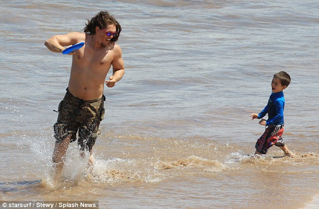 Catch me if you can: William tried to catch his laughing father who ran with the frisbee