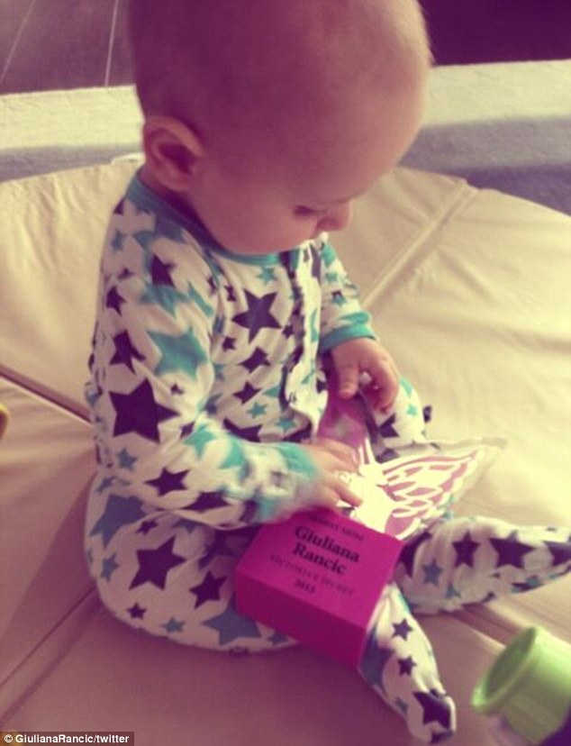 His mother's son: Edward Duke plays with a free gift from Victoria's Secret, one of many pics Giuliana has posted of him since he was born