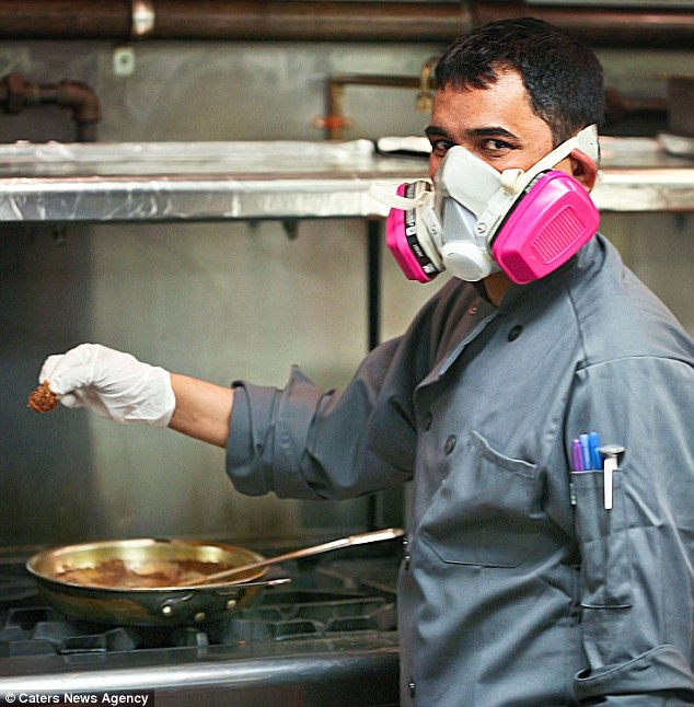 The dish is so spicy chefs have to wear gas masks as they prepare it