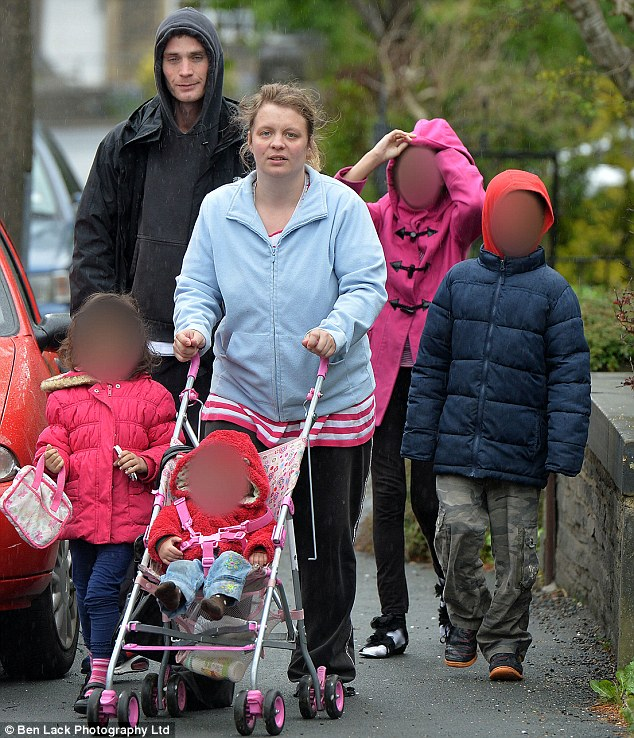 Family: Jobless and single Lauren Beckham (pictured with an unidentified man), 31, verbally abused her four mixed-race children - aged from one to 12 - 'day in and day out' since she moved into a house last July