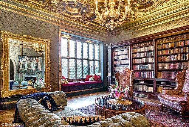Nice quiet spot for a read: The luxurious library gives no hints that one of the shelves is not actually a shelf but the opening to the door leading to the speakeasy
