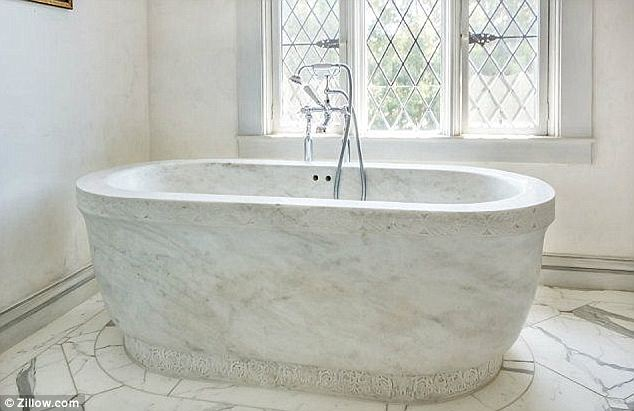 Tub with a view: The sleek current look is far from what it looked like when the Porters bought it in 1999, as they described it as looking like 'a beat-up fraternity house'
