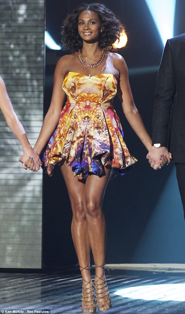 A brave choice: Alesha's sexy multi-coloured printed number by Alexander McQueen certainly ensured she was the centre of attention