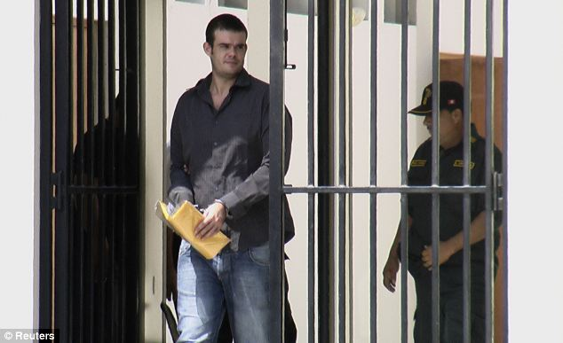 Joran Van der Sloot walks handcuffed to a courtroom at the Piedras Gordas prison in Lima last May to fight extradition from Peru to the U.S.