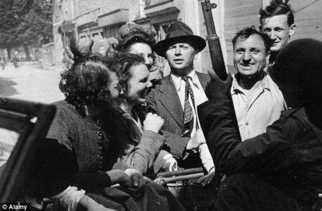 All smiles: The population of Valognes welcoming US soldiers in 1944