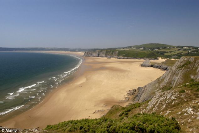 Beauty spot: Geoffrey Baker was birdwatching on a hill overlooking the stunning Three Cliffs bay in Gower Peninsula near Swansea when he photographed the 'two-headed horse'