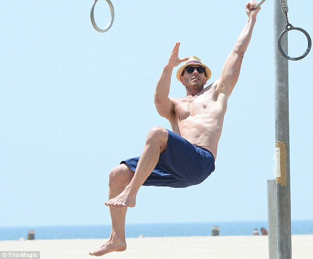 Upper body strength: Ian Ziering showed off some mad skills on the beach in Santa Monica on Friday