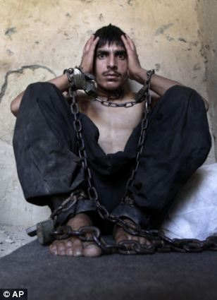 Nabiullah Safi, 23, a drug addict, is chained to a wall during his 40-day incarceration at the Mia Ali Baba shrine in Jalalabad, Afghanistan