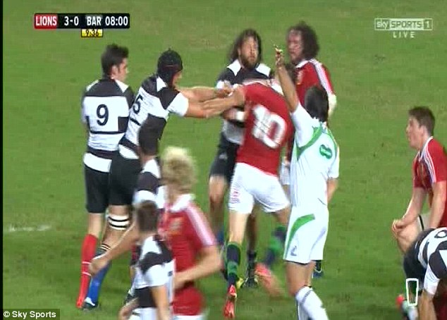 Flashpoint: Farrell fought with club-mate Schalk Brits in the Lions' 59-8 mauling of the Barbarians