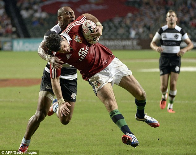Try time: Mike Phillips wrestles with Joe Rokocoko as he gets over the line