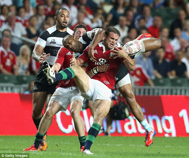 Hot potato: Jamie Roberts clashes with All Black legend Joe Rokocoko at the start of the second half