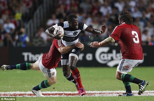Baa-Baa bite: Takudzwa Ngwenya is tackled by Adam Jones (whose shirt is soaked with sweat) and Jamie Roberts
