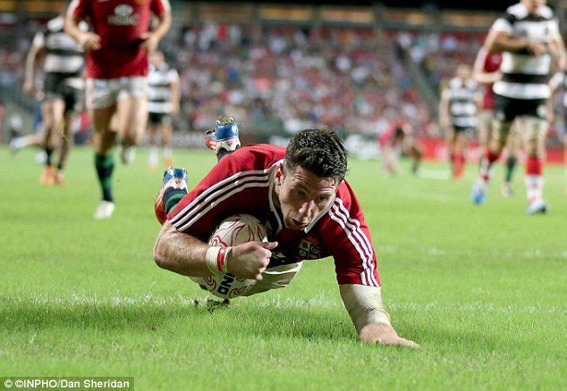 Double trouble: Wales wing Alex Cuthbert canters in for his second try at the Hong Kong stadium
