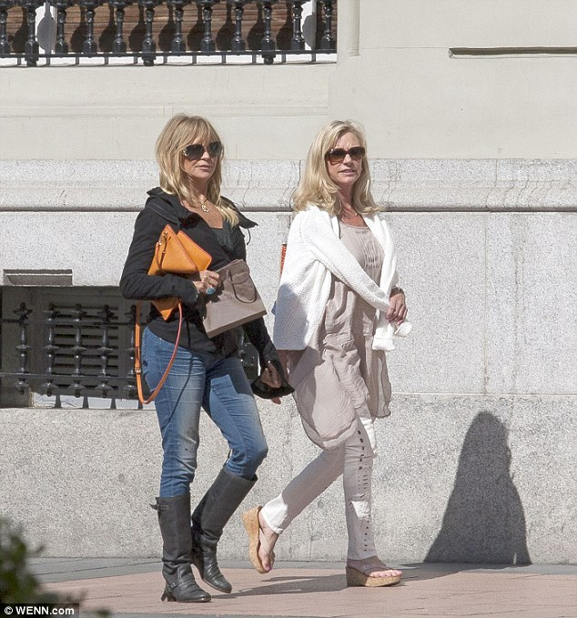 Sunshine break: Goldie Hawn looks healthy and happy as she wanders around Madrid with a girl pal on Friday afternoon