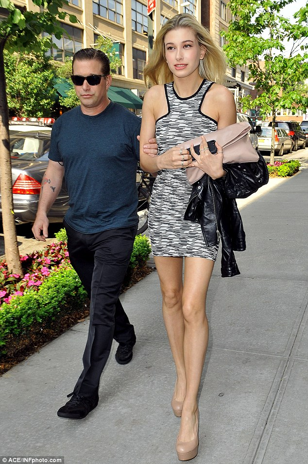 Keeping a close watch: Hailey's father was acting protective as she stepped out in her mini-dress and nude platform heels