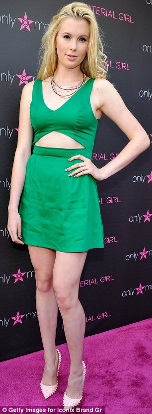 Green with envy: Ireland Baldwin (L) jokingly tweeted that she's 'cuter' than her 'pretty' cousin Hailey Baldwin