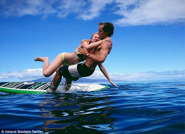 New meaning for body surfing: Ireland changed topics and tweeted a picture of herself surfing with boyfriend Slater Trout, writing 'This.is.love'
