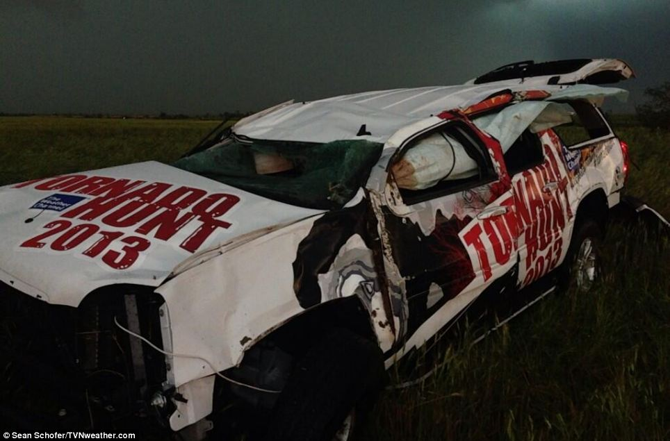 Injuries: A meteorologist from The Weather Channel was injured after his car (seen here) was thrown 200 yards by the storm