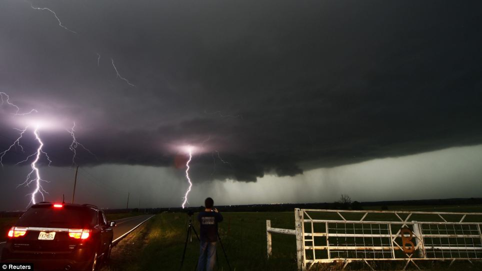 A storm chaser in Cushing stopped to take photos of the dramatic moment two lightning strikes hit the ground