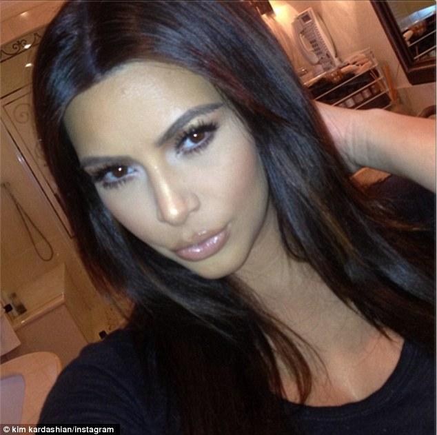 Pretty please? The brunette socialite, due in July, reportedly had to 'beg' her boyfriend Kanye West to make an appearance at her televised baby shower on Sunday
