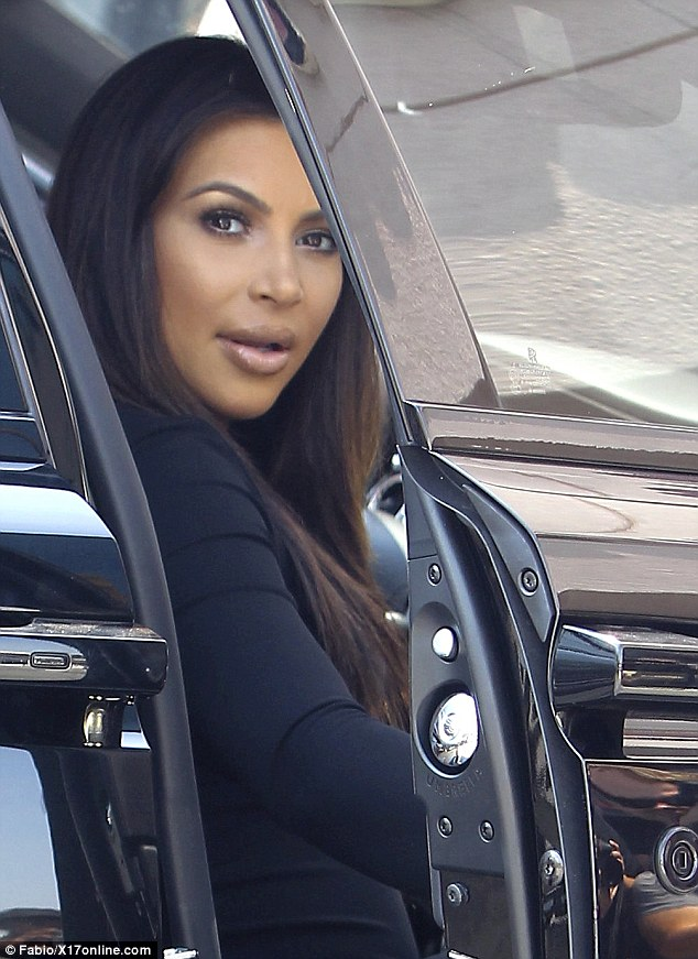 Peekaboo: Pregnant Kim Kardashian opted to have a relaxing 'fun glam day' on Friday, staying inside the car for a fro-yo run before meeting up with her family