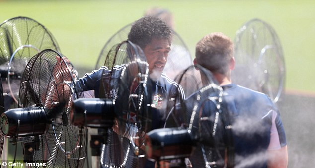 Cool down: No 8 Toby Faletau shoots the breeze with the giant outdoor fans