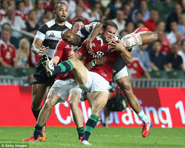 Colossal collision: Jamie Roberts clambers for the ball with All Black legend Joe Rokocoko