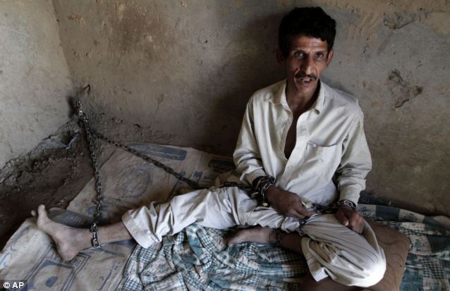 Stark conditions: Shafi, 38, is another drug addict. The men are only able to wash their face and hands while at the shrine and talking is prohibited