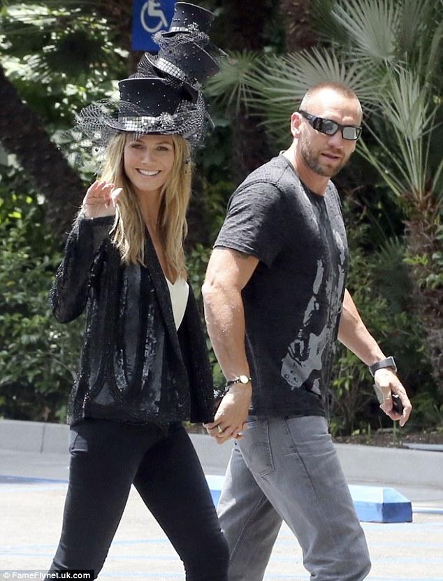 Happy 40th! Heidi Klum walked hand-in-hand with boyfriend Martin Kristen to her birthday bash at Hotel Bel-Air on Saturday