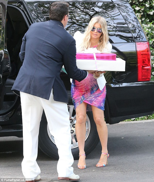 Gifted: The pop singer arrived with her arms full of presents for Heidi