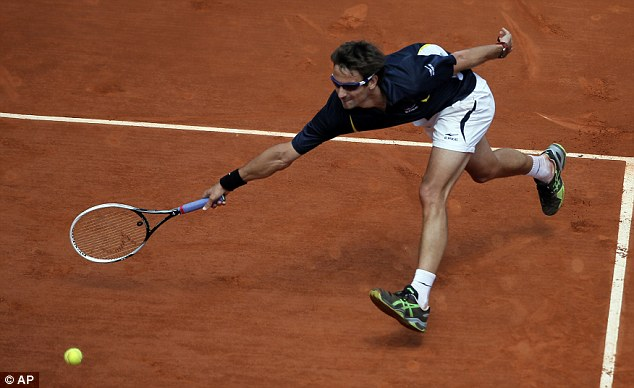 Stretch: Tommy Robredo reaches for a ball in his epic win