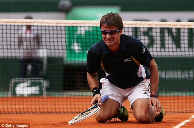 In tears: Tommy Robredo sinks to his knees after his third stunning fightback of the week