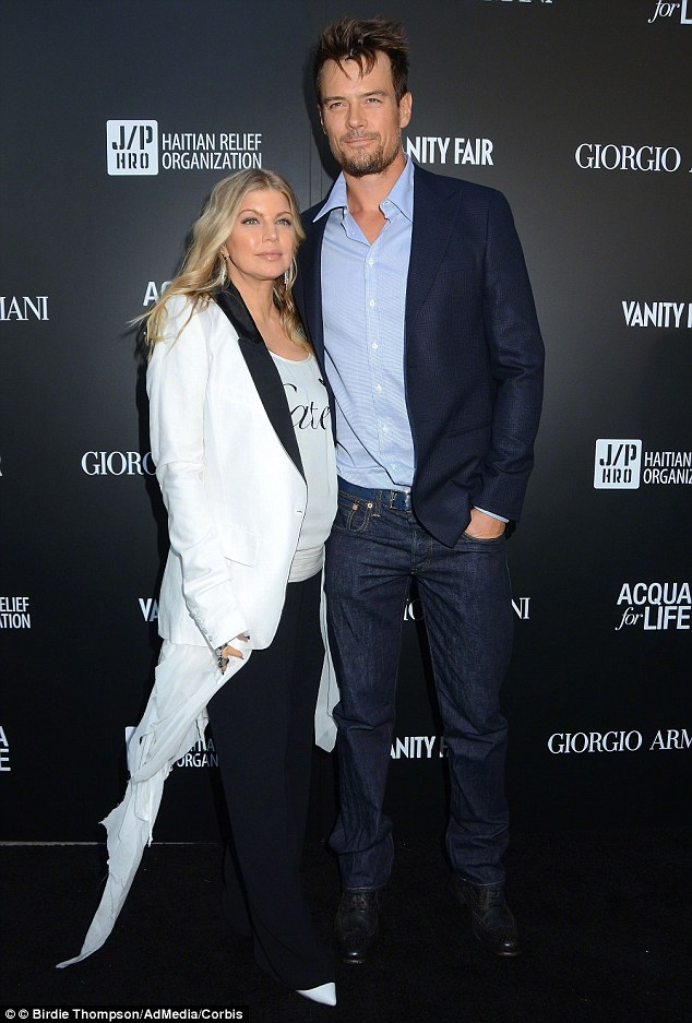 Making a statement: Fergie, seen here at a fashion event in April with husband Josh Duhamel, is very creative with her wardrobe