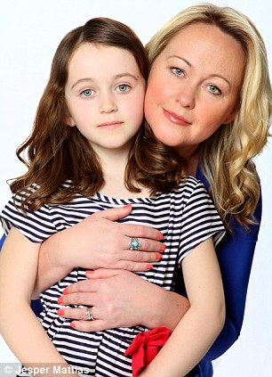 Sara, pictured with daughter Mia, became curious about what could have caused her bolt of panic