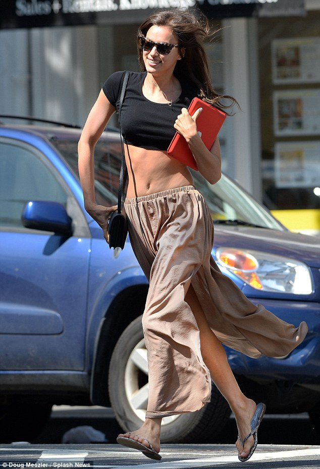 Run for fun: Irina Shayk displayed how she stays in such slender shape on Sunday when she picked up her feet and sprinted to lunch