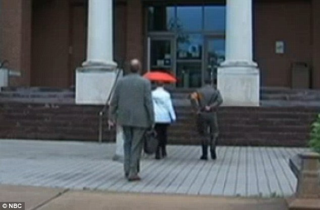 Controversial: Campbell, who has his own neo-Nazi organization, walks into court with a supporter wearing knee-high boots and a swastika arm band