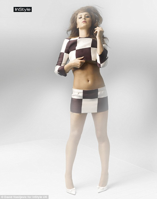Checkerboard chic: Cheryl Cole shows off her toned tummy as she poses for the July issue of InStyle
