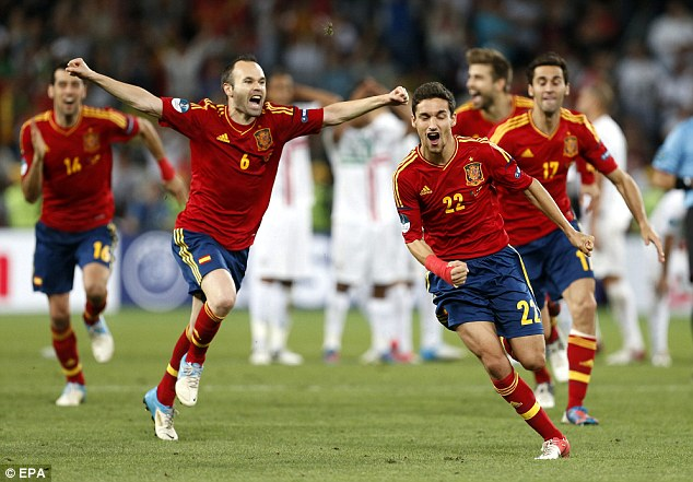 Shoot-out joy: Navas (right) and Andres Iniesta in wonderland after Spain beat Portugal on penalties in the semi-finals of Euro 2012